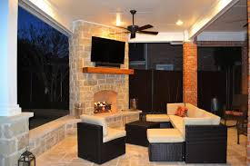 outdoor living area with corner fireplace in irving las colinas