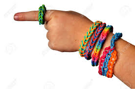 hand rubber bracelet images Little boy wearing colorful loom band rubber bracelets and ring jpg