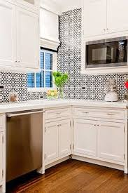 kitchen backsplash tile designs this patterned tile is the focal point in this white kitchen cool