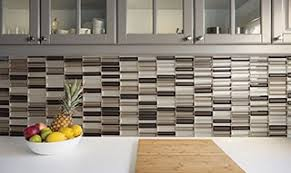 white kitchen cabinets with taupe backsplash glass tile adds modern flair to any room daltile