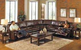oversized leather sectional sofa with 2 recliners in chocolate oversized leather sectional sofa with 2 recliners in chocolate color and wooden coffee table on shag