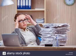 Secretary Under The Desk by Busy Stressful Woman Secretary Under Stress In The Office Stock