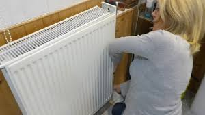 jan shows how to remove radiator covers to clean the dust out