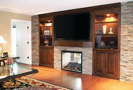 dark brown wooden shelves connected by beige stone fireplace and