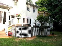 elevated composite deck with white railing and white lattice