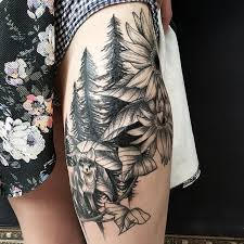 black ink nature trees with wolf and flowers on thigh