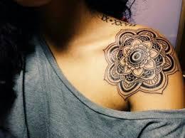 black mandala design on left front shoulder