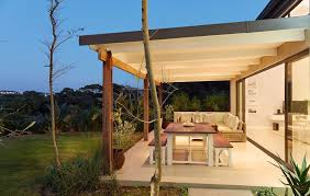 amazing backyard patio covers with stucco post beam stone fire pit