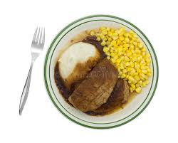 cuisine tv plus meatloaf with gravy potatoes and corn tv dinner on plate stock photo