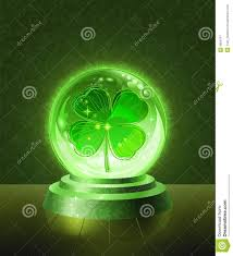 lucky four leaf clover inside the crystal ball royalty free stock