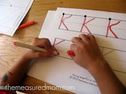 teach kids to write the alphabet set up stations at the kitchen