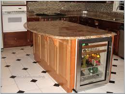 black wooden access door storage granite kitchen countertop