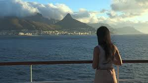 clip in hair cape town up of girl viewing cape town at sunset from the deck of a