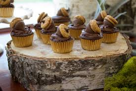 acorn topped cupcakes at woodland baby shower baby oy shower