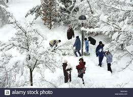 parents children garden snow play together people men women adults