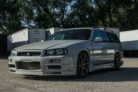 nissan skyline r34 modified nissan stagea r34 gt r wagon will make you the coolest kid on the