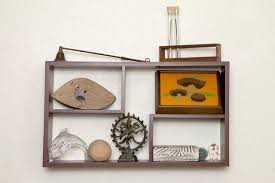 on a shelf the height to hang decorative shelves on a wall hunker