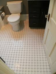 two inch white hex tiles with gray insets shine on the