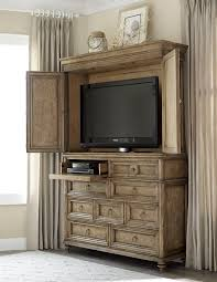 this grand armoire offers great style and function to a bedroom or