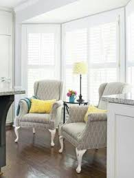 i really like this pair of chairs in front of the windows angled
