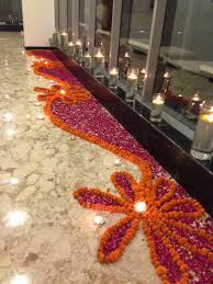 floral rangoli for a diwali party with crystal tealights rangoli