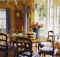 french country dining room using gingham curtains and pads with