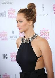 side view of pulled back hair in a bun jennifer lawrence updo with the hair pulled back and wrapped