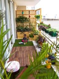 you can make a small balcony feel cozy by installing some hanging