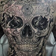sugar skull on back by antony flemming cars bikes n