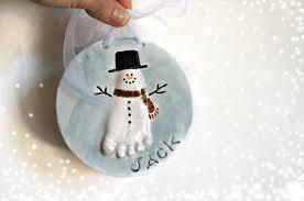 thebabyhandprintcompany snowman and footprint ornaments with
