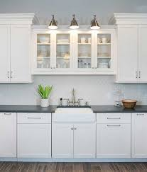 kitchen cabinets above sink the problem with choosing white kitchen cabinets normandy