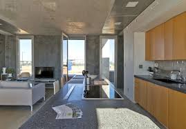 interior homes this striking concrete home uses mesh walls to connect with nature