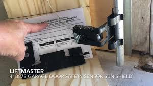 Garage Door Sensor Blinking by How To Install Garage Door Safety Sensor Sun Shield Youtube