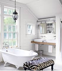 love this bathroom aside from the animal print ottoman its farm