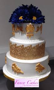 gold and navy blue wedding cake cake by michelle edwards