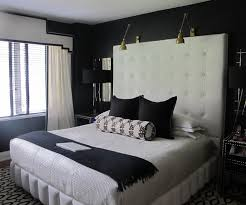 bedroom white leather tufted headboard with brass arm lights