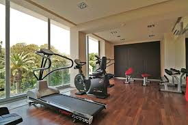 modern open home gym interior with floor to ceiling windows design