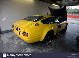 ferrari classic race car a yellow ferrari daytona classic racing car sitting in a garage
