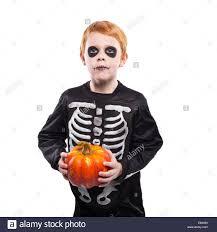 halloween skeleton costume portrait of little red haired boy wearing halloween skeleton