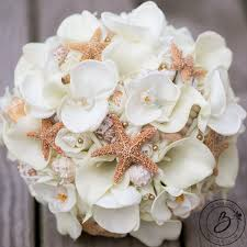 wedding flowers orchids gold bouquet seashell and starfish bouquet calla