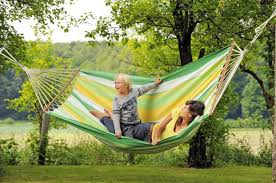 the hammock in the garden provides a pleasant relaxation hum ideas