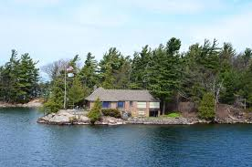 Beach House Usa - one small island and beach house on st lawrence river editorial