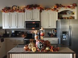 how to decorate above kitchen cabinets for fall starter home fall decor small kitchen fall decorations