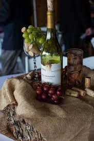 wedding centerpieces for wine themed wedding at rustic farm wine