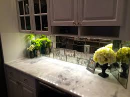 bathroom inspiring mirrored tile backsplash with white marble