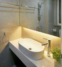 beautiful under cabinet bathroom lighting created by using warm