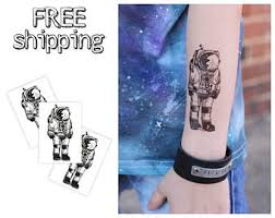 spaceman tattoo etsy