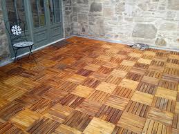 interlocking outdoor patio tiles cover the soil and beautify