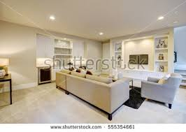 chic basement features gray sectional facing stock photo 555911128