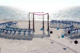 wonderful oceanside pathway wedding decor design with curve chairs